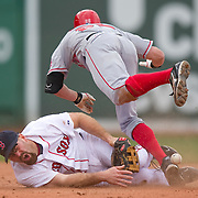Boston, MA May 5, 2011: .Peter Bourjos of the Los Angles Angels of Anaheim collides with Kevin Youkils of the  Boston Red Sox  at second base after hitting a double during the fifth inning at Fenway Park. ..(Photo by Michael Ivins/Boston Red Sox)