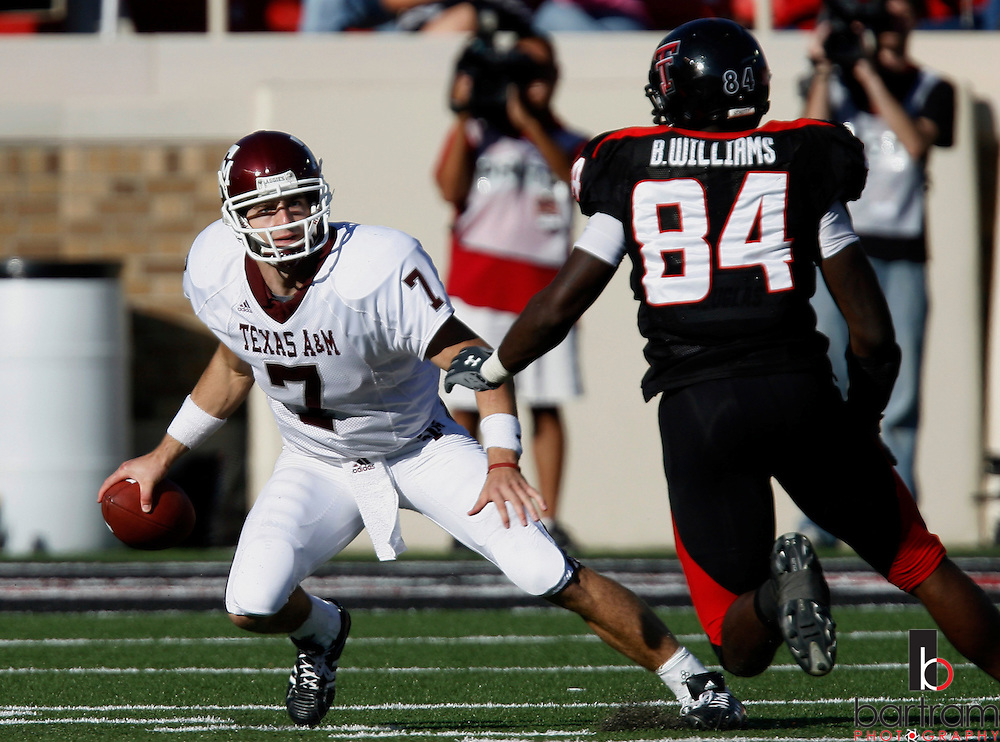 Texas A&M quarterback Stephen McGee attempts to scramble past Texas Tech defensive end Brandon Williams on Saturday, Oct. 13, 2007 in Lubbock, Texas. Texas Tech won the game 35-7.