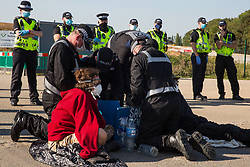 A Hertfordshire Police cutting team works to remove two environmental activists from HS2 Rebellion who used a lock-on arm tube to block a gate to the South Portal site for the HS2 high-speed rail link on 14 September 2020 in West Hyde, United Kingdom. Anti-HS2 activists blocked two gates to the same works site for the controversial £106bn rail link, one remaining closed for over six hours and another for over twelve hours.