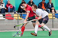 ROTTERDAM - Civicum - de Ijsel , Hockey playoffs , Hockey , Hockey club Leonidas , 21-06-2015 ,  Civicum speler nr 10 (l) in duel met De Ijsel speler (r)