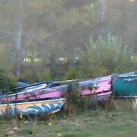 Grouping of boats ordered built, but never collected sitting on the ground and going back to earth. The fog in the background adds a sense of mystery to the scene. The colors are wonderful.