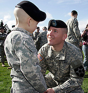 Sgt. Kirby Odom, of Cartersville, Ga. talks to his son Collin, age 6, after the deployment ceremony for the Army 4th Brigade, 2nd Infantry Division Stryker Brigade at Fort Lewis, WA. (AP Photo/John Froschauer)
