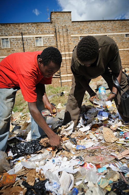 Streetboys collecting plastic from a rubbish dump, Thika, Kenya.