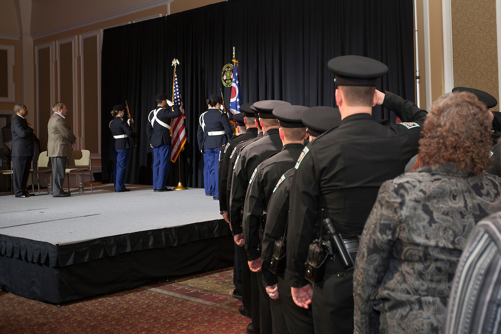 Ohio University police officers salute ROTC students at the Badge Pinning and Employee Recognition Ceremony on Monday, February 8, 2016. Photo by Kaitlin Owens