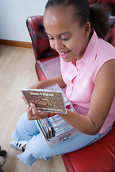 Young woman selecting a CD to play,