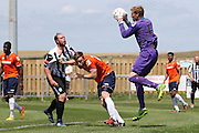 Luton Town keeper Elliot Justham makes a save during the Pre-Season Friendly match between Peacehaven & Telscombe and Luton Town at the Peacehaven Football Club, Peacehaven, United Kingdom on 18 July 2015. Photo by Ellie Hoad.