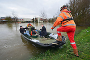© Licensed to London News Pictures. 10/02/2014. Old Windsor, UK. Staff are using boats to go to work at the hotel Runnymeade on the Thames.  Flooding in OLD WINDSOR in Berkshire today 10th February 2014 after the River Thames burst its banks. The Environment Agency has issued 14 Severe Flood Warnings alone the Thames. Photo credit : Stephen Simpson/LNP