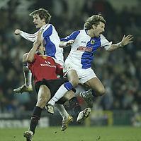 Photo: Aidan Ellis.<br /> Blackburn v Manchester United. Barclays Premiership. 01/02/2006.<br /> United's Rio Ferdinand is sent off for this challenge on Blackburn's Robbie Savage