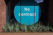 A No Contract sign in the window of a new PureGym, on 2nd March 2017, in Camberwell, London borough of Southwark, England. PureGym Limited is a chain of no frills fitness clubs in the United Kingdom. The chain is based in Leeds and has gyms across the UK. It is Britain's largest gym chain by membership with about 450,000 members currently signed up and has plans to open 300 gyms by 2020.