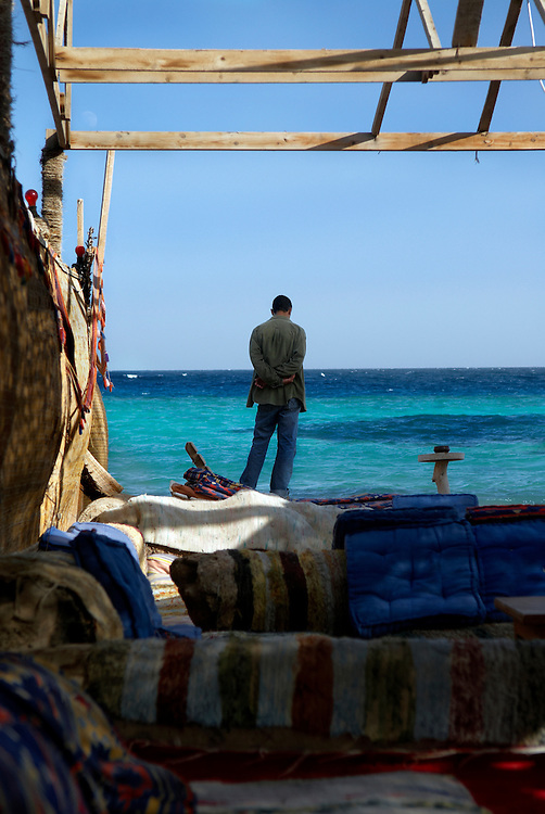 Egypt, Dahab. December/08/2008...A quiet moment, looking out over the Red Sea...