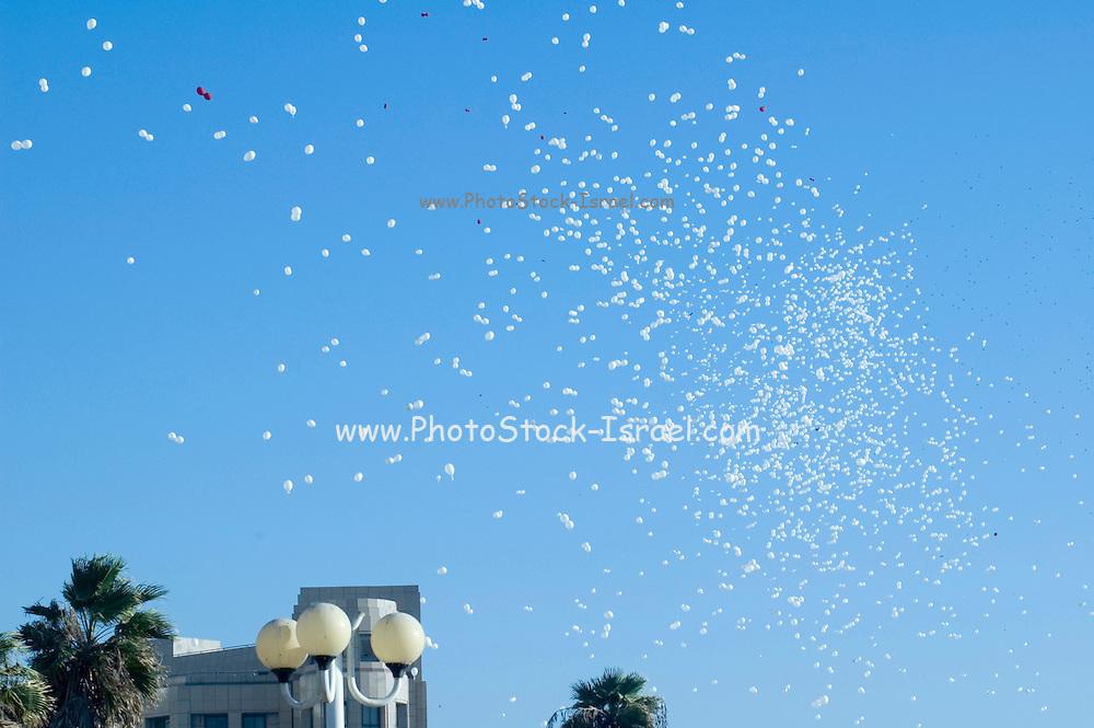 Helium balloons flying over head