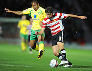 Doncaster - Tuesday September 14th, 2010:  Norwich City's Simeon Jackson and Doncaster Rovers's George Friend in action during the NPower Championship match at Keepmoat Stadium, Doncaster. (Pic by Dave Howarth/Focus Images)