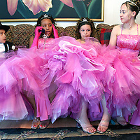 """Ladies in Waiting"" Attendants in a Quinceanera (sweet 15) celebration wait for the girl of honor as she gets ready in her family's apartment in Lowell, MA. aljot"