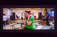 Bellmore, New York, USA. July 18, 2018. In short film The Adventures of Penny Patterson, the title character, played by actor AJNA JAI, calls Steve, her boyfriend and lab partner, who isn't helping with their science fair project. Penny didn't notice Steve was superhero behind her in high school cafeteria. The comedy, sci-fi, woman directed film was nominated for Best Student Film at LIIFE 2018, the Long Island International Film Expo.