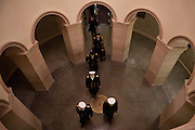 Military officers file through the US Capitol during the presidential inauguration, January 21, 2013.