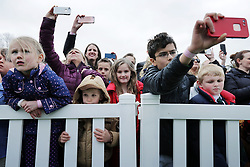 WASHINGTON, DC - APRIL 02: (AFP OUT) Children line the fence while listening to U.S. President Donald Trump deliver remarks during the 140th annual Easter Egg Roll on the South Lawn of the White House April 2, 2018 in Washington, DC. The White House said they are expecting 30,000 children and adults to participate in the annual tradition of rolling colored eggs down the White House lawn that was started by President Rutherford B. Hayes in 1878. (Photo by Chip Somodevilla/Getty Images)
