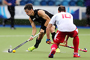 Simon Child of New Zealand in action during the bronze medal match between New Zealand and England. Glasgow 2014 Commonwealth Games. Hockey, Bronze Medal Match, Black Sticks Men v England, Glasgow Green Hockey Centre, Glasgow, Scotland. Sunday 3 August 2014. Photo: Anthony Au-Yeung / photosport.co.nz