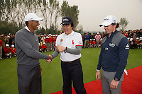 Tiger Woods of USA, left greets Feng Changge Chairman of the Harmony Group as Rory McIlroy of Northern Ireland  looks on after completion of the Duel at Jinsha Lake at the Golf Villa Jinsha Lake on October 29, 2012 in Zhengzhou, China.  Photograph by David Paul Morris