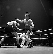 15/03/1963<br /> 03/15/1963<br /> 15 March 1963<br /> National Senior Boxing Championships at the National Stadium, Dublin. J. Henry (right) Hollerith Boxing Club, Belfast, tries a right to the body of P. McDonnell, Drogheda B.C., but the latter ducks, during their 1st Series Bantamweight Contest. Henry won on points.