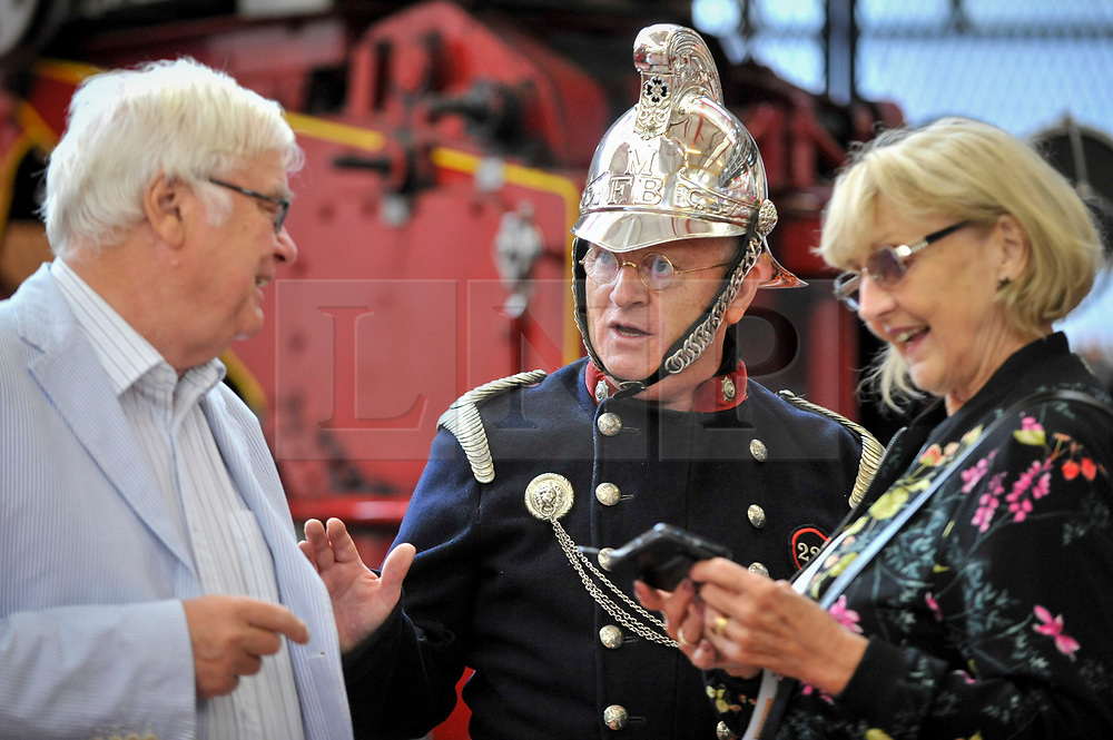 © Licensed to London News Pictures. 09/09/2017. London, UK. Visitors meet a staff member dressed as a vintage fireman during London Fire Brigade's annual Fire Engine Festival in Lambeth.  The earliest motorised fire engines still working, London Fire Brigade's brand new pump as well as firefighter uniforms are on display. Photo credit : Stephen Chung/LNP