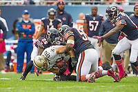 06 October 2013: Tight end (80) Jimmy Graham of the New Orleans Saints catches a pass and is tackled by (26) Tim Jennings and (55) Lance Briggs of the Chicago Bears during the second half of the Saints 26-18 victory over the Bears in an NFL Game at Soldier Field in Chicago, IL.