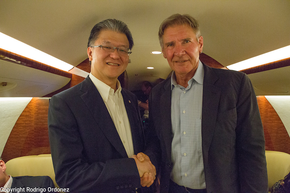 Palm oil executive Franky Oesman Widjaja (left) and actor and environmental activist Harrison Ford pose for a photograph onboard a private jet at Halim Perdanakusuma Airport in East Jakarta, Indonesia. Mr Widjaja is the Chairman and Chief Executive Officer of the Agribusiness &amp; Food division of the Sinar Mas Group, one of the world's largest palm oil producers. <br /> Harrison Ford visited Indonesia to learn more about deforestation, as one of the correspondents for Showtime's new documentary series about climate change Years of Living Dangerously.