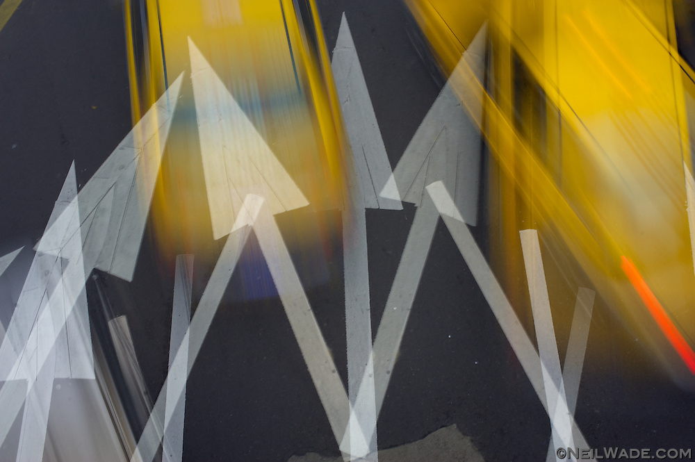 Multiple exposure of traffic and traffic arrows in Taipei, Taiwan.