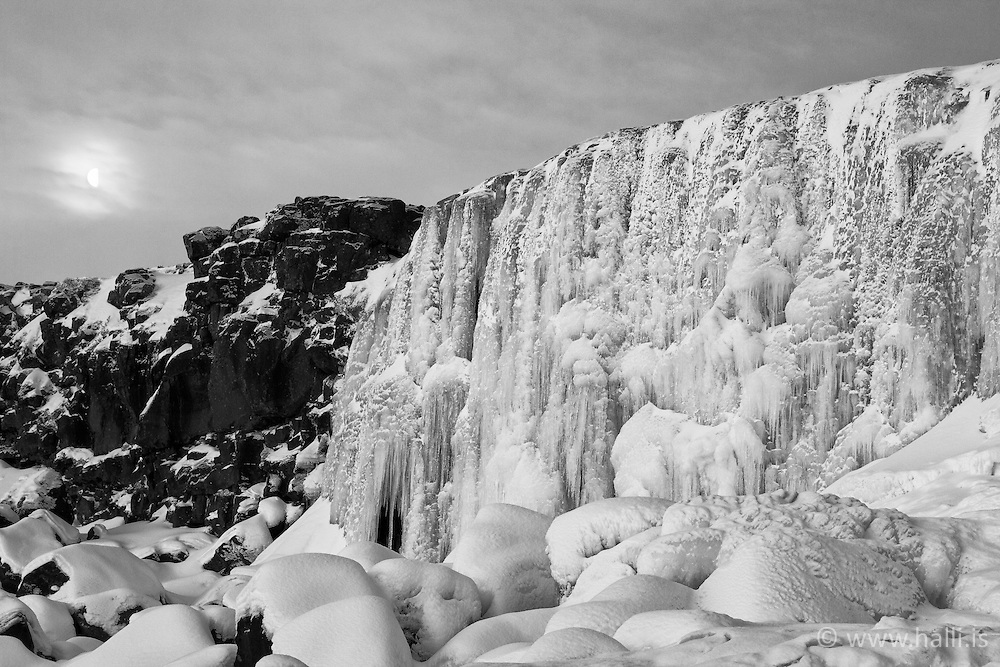 The waterfall Oxararfoss covered with ice, Iceland - Öxarárfoss í klakaböndum