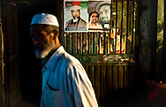 A man walks in front of a campaign poster for Presidential Candidate Abdullah Abdullah in Kabul, Afghanistan August 12, 2009. 41 candidates are due to run in Afghanistan's presidential elections which are to be held on August 20. The incumbent president Karzai is considered to be the frontrunner despite claims of corruption and what many consider an ineffectual government.