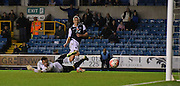Steve Morrison watches his shot go in during the The FA Cup match between Millwall and Flyde at The Den, London, England on 7 November 2015. Photo by Michael Hulf.