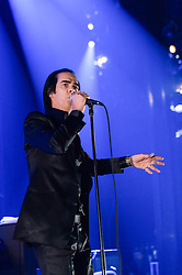 © Licensed to London News Pictures. 26/10/2013. London, UK.   Nick Cave and the Bad Seeds performing live at Hammersmith Apollo. In this pic - Nick Cave.  Photo credit : Richard Isaac/LNP