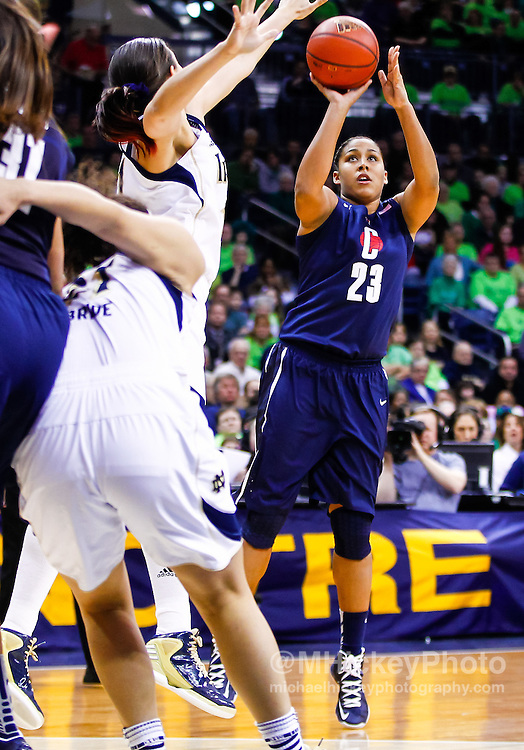 SOUTH BEND, IN - MARCH 04: Kaleena Mosqueda-Lewis #23 of the Connecticut Huskies shoots the ball against Natalie Achonwa #11 of the Notre Dame Fighting Irish at Purcel Pavilion on March 4, 2013 in South Bend, Indiana. Notre Dame defeated Connecticut 96-87 in triple overtime to win the Big East regular season title. (Photo by Michael Hickey/Getty Images) *** Local Caption *** Kaleena Mosqueda-Lewis  Natalie Achonwa