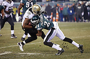 Philadelphia Eagles cornerback Bradley Fletcher (24) tackles New Orleans Saints wide receiver Marques Colston (12) after a 6 yard reception to the Eagles 27 yard line in the fourth quarter during the NFL NFC Wild Card football game against the New Orleans Saints on Saturday, Jan. 4, 2014 in Philadelphia. The Saints won the game 26-24. ©Paul Anthony Spinelli