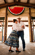 John and Erlene Zavadil of Gonzales, Texas dance to the music of the Shriner Hobo Band under the pavilion at the Luling Watermelon Thump on Saturday.