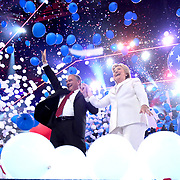 Democratic vice presidential nominee Tim Kaine and presidential candidate Hillary Clinton are seen on stage during the final night of the Democratic National Convention at the Wells Fargo Arena in Philadelphia, Pa. on Thursday, July 28, 2016.