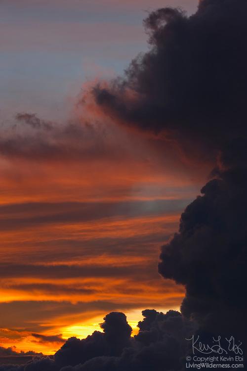 Storm clouds over Haleakala National Park on the Hawaiian island of Maui are colored by the setting sun.