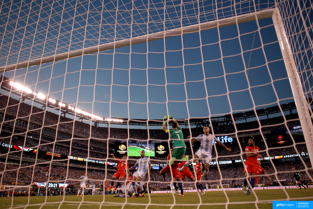 EAST RUTHERFORD, NEW JERSEY - JUNE 26:  Claudio Bravo #1 of Chile takes a cross into the penalty area during the Argentina Vs Chile Final match of the Copa America Centenario USA 2016 Tournament at MetLife Stadium on June 26, 2016 in East Rutherford, New Jersey. (Photo by Tim Clayton/Corbis via Getty Images)