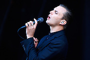 Theo Hutchcraft of Hurts performs live on the main stage during day two of the Isle of Wight Festival 2011 at Seaclose Park on June 11, 2011 in Newport, Isle of Wight.  (Photo by Simone Joyner)