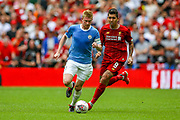 Manchester City midfielder Kevin de Bruyne (17) under pressure from Liverpool striker Roberto Firmino (9) during the FA Community Shield match between Manchester City and Liverpool at Wembley Stadium, London, England on 4 August 2019.