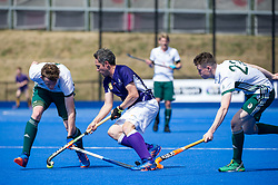 Sevenoaks's Duncan Parnis is tackled by Will Heywood and Tom Bean of Canterbury. Canterbury v Sevenoaks - Men's Hockey League Finals, Lee Valley Hockey & Tennis Centre, London, UK on 23 April 2017. Photo: Simon Parker