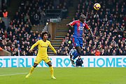 Chelsea midfielder Willian (22) looks on as Crystal Palace defender	Mamadou Sakho (12) jumps high to deny him of the ball during the Premier League match between Crystal Palace and Chelsea at Selhurst Park, London, England on 30 December 2018.