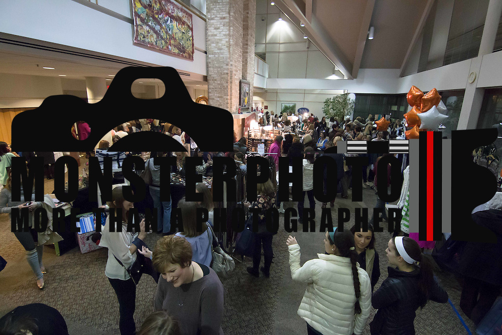 800 plus Shoppers browse various vendors during the 3rd Annual Guilty Girls Warehouse Sale Friday, Feb. 06, 2015 at University of Delaware's Arsht Hall in Wilmington, DE.