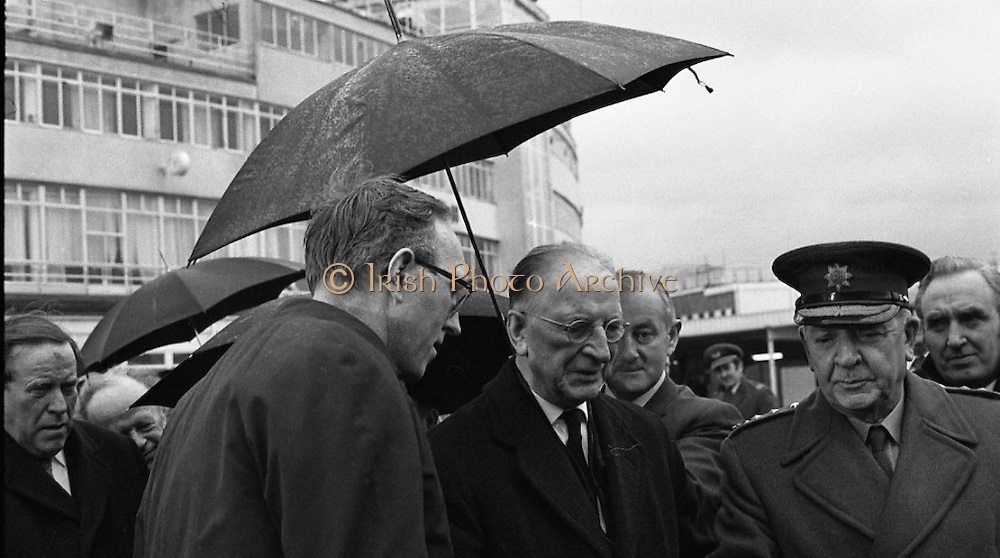 Archbishop Ryan Returns From Rome..1972..16.02.1972..02.16.1972..16th February 1972..After his official appointment as Archbishop of Dublin by Pope Paul VI, Dr Dermot Ryan returned to Dublin for his installation as Archbishop on Feb 22nd at the Pro Cathedral,Dublin..Image of The President,Eamon DeValera,as he braves the weather to greet Dr Dermot Ryan on his arrival at Dublin Airport.