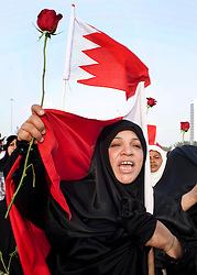 © under license to London News Pictures. 21/02/2011. Protesters march around Pearl Roundabout in Manama, Bahrain where thousands of people have gathered to protest for government reforms. Photo credit should read Michael Graae/London News Pictures
