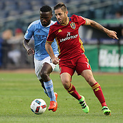 NEW YORK, NEW YORK - June 02: Juan Martinez #7 of Real Salt Lake is challenged by Stiven Mendoza #9 of New York City FC during the NYCFC Vs Real Salt Lake regular season MLS game at Yankee Stadium on June 02, 2016 in New York City. (Photo by Tim Clayton/Corbis via Getty Images)