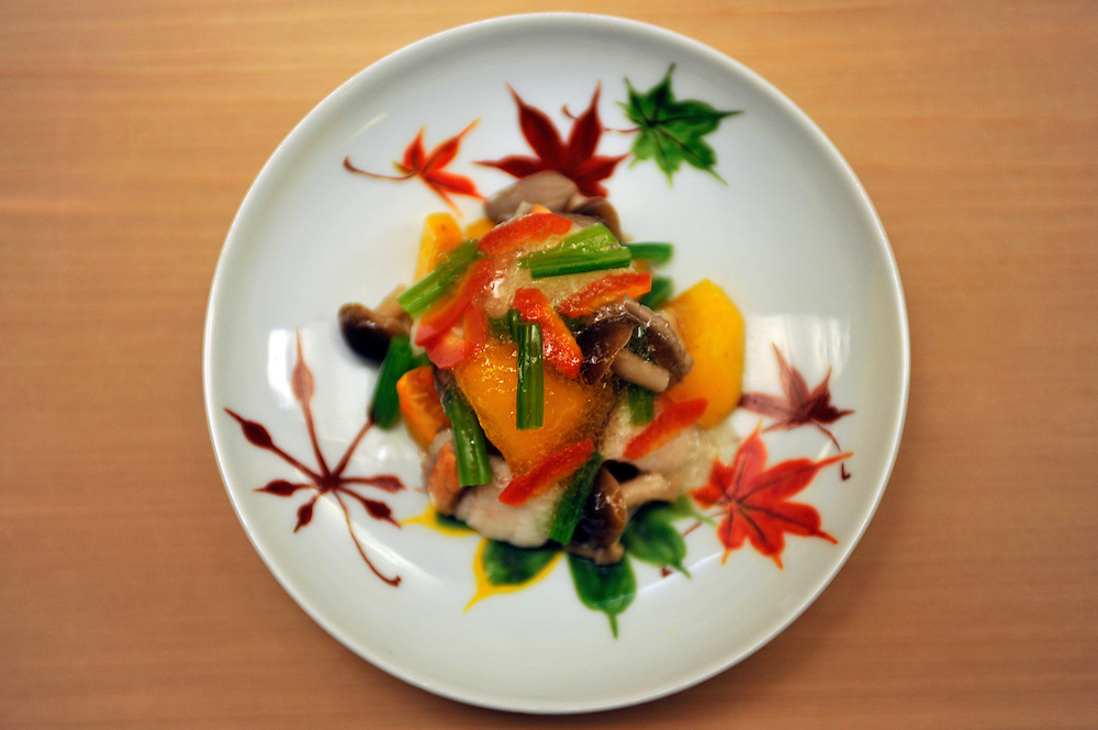 Japanese traditional restaurant CHIHANA..An autumn dish with mushrooms Kaki 2 types of fishes and a wine sauce