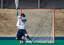 A shot gets past Virginia Goalie Bud Petit (8).  The Virginia Cavaliers scrimmaged the Navy Midshipmen in lacrosse at the University Hall Turf Field  in Charlottesville, VA on February 2, 2008.