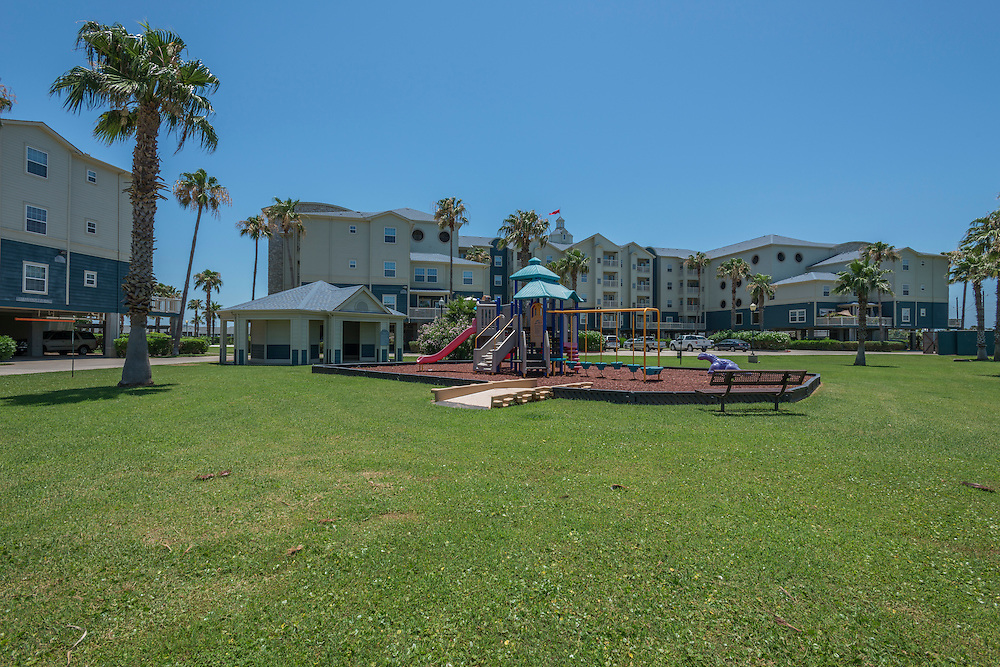 Photograph of the Marquette Club of the Isle Apartments in Galveston, Texas, near the western end of the seawall.