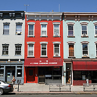 Row Houses and apartment building line Washington Street, the main thoroughfare in Hoboken, New Jersey, USA. Most buildings house shops as the street serves as a center for shopping and restaurants.