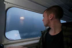 NORWAY BARENTS SEA 6DEC15 - Greenpeace campaigner Erlend Tellnes of Norway surveys the production platform Goliat in the Barents Sea operated by Italian energy compay Eni. It is the world's most northerly oil production platform.<br /> <br /> jre/Photo by Jiri Rezac / Greenpeace<br /> <br /> © Jiri Rezac 2015